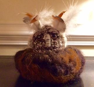 grumpy owl in nest