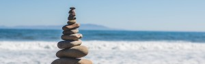 Stacked Rocks and Sea in Newquay Cornwall by Healing Hands