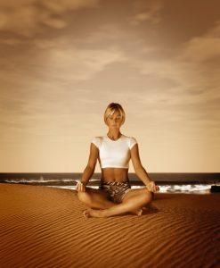Woman Meditating at the Beach ca. 2001