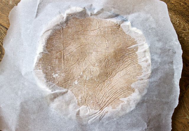tarte tatin crust dough over tin covered in baking parchment