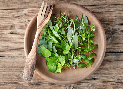 Herbs in a wooden plate