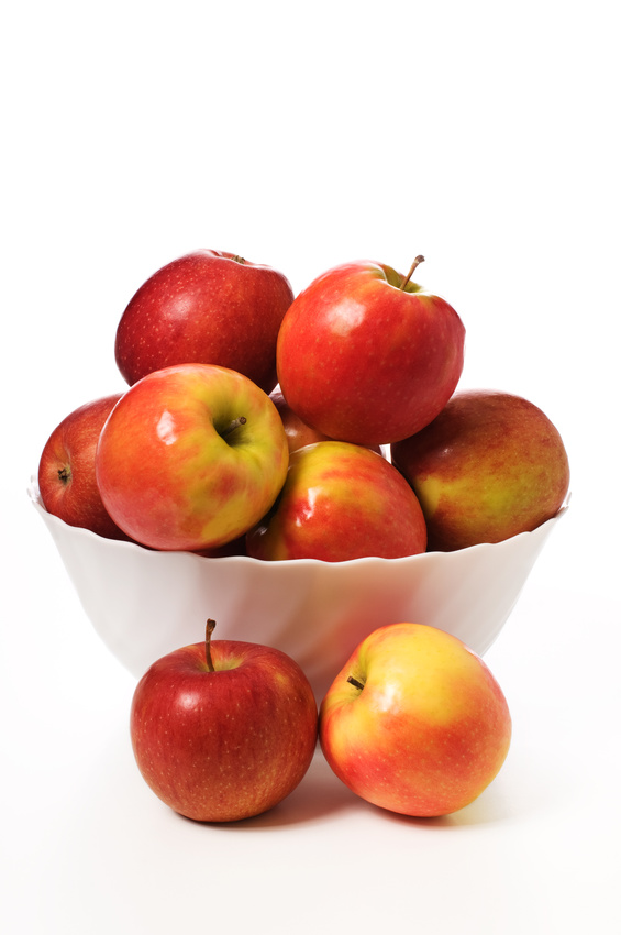 red apples in a while bowl on a white background