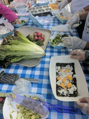 Students make Garden Sushi Cups, Wraps, and Rolls in the garden.