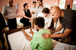 Being in the Room Where It Happens: Loan Repayment and Global Health
