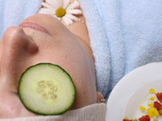 woman with cucumber on eyes, skincare regimen