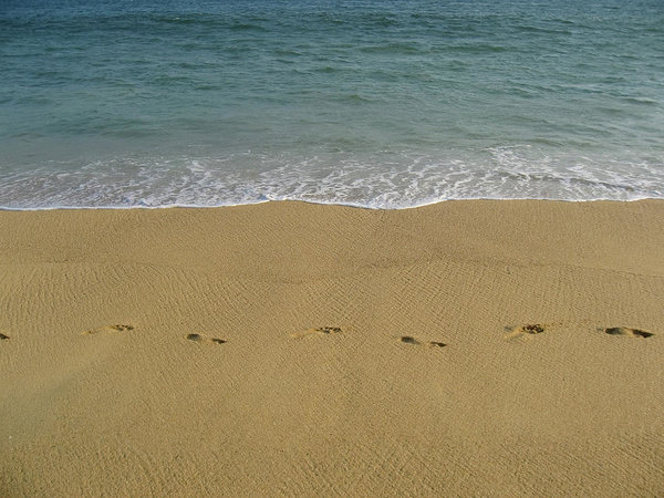 Seawater, beach and footprints in Acapulco