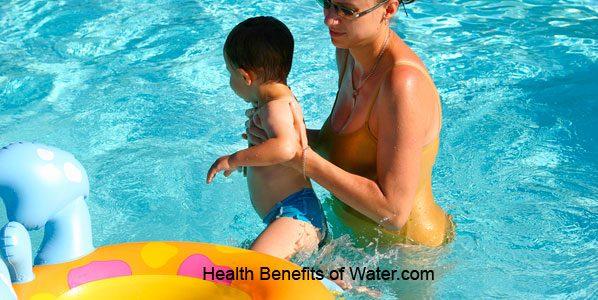 Mother encouraging kid to swim