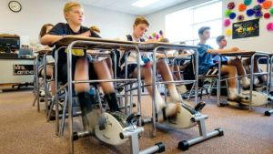 Image of middle school student pedaling in NC classroom