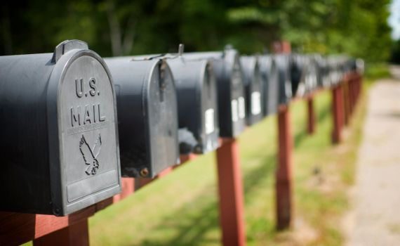 Row of U.S. mailboxes on the side of a residential street