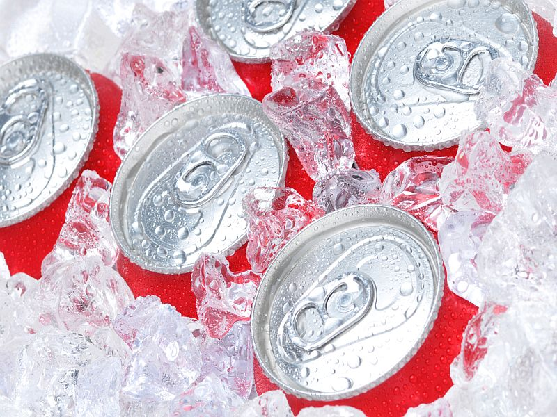 Close Up of Soda Cans in Ice with Condensation