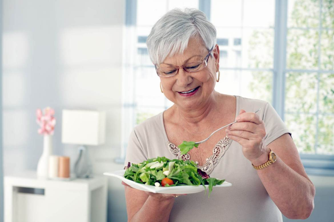 Elderly Woman Eating Salad