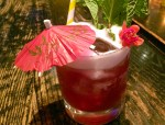 Natural cocktail on bar with umbrella