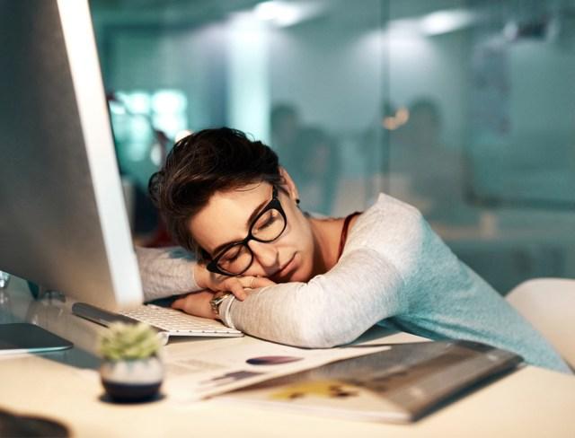 Women sleeping at computer