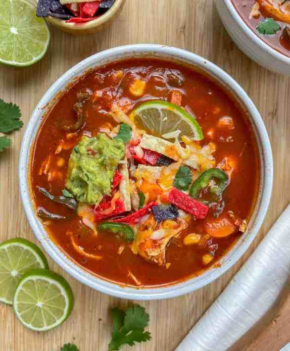 Chicken Tortilla Soup with guacamole and cheese on top