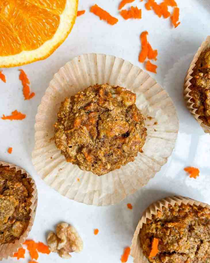 Healthy spiced carrot orange muffins full of feel good ingredients. These morning muffins are naturally sweetened, dairy free, gluten free, and made with rolled oats. A nutritious, kid-friendly breakfast or snack! They are irresistibly delicious, super moist, perfectly spiced.
