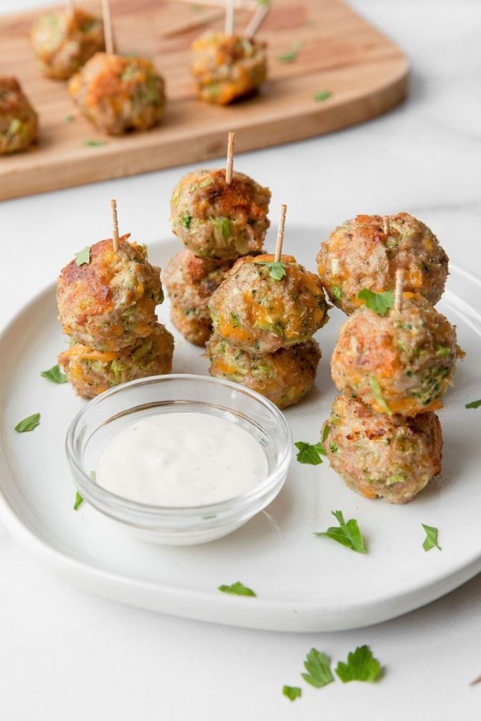 Stacked broccoli cheddar cheese turkey meatball poppers. Served with ranch dressing or caesar dressing. The perfect healthy meatball appetizer bites.