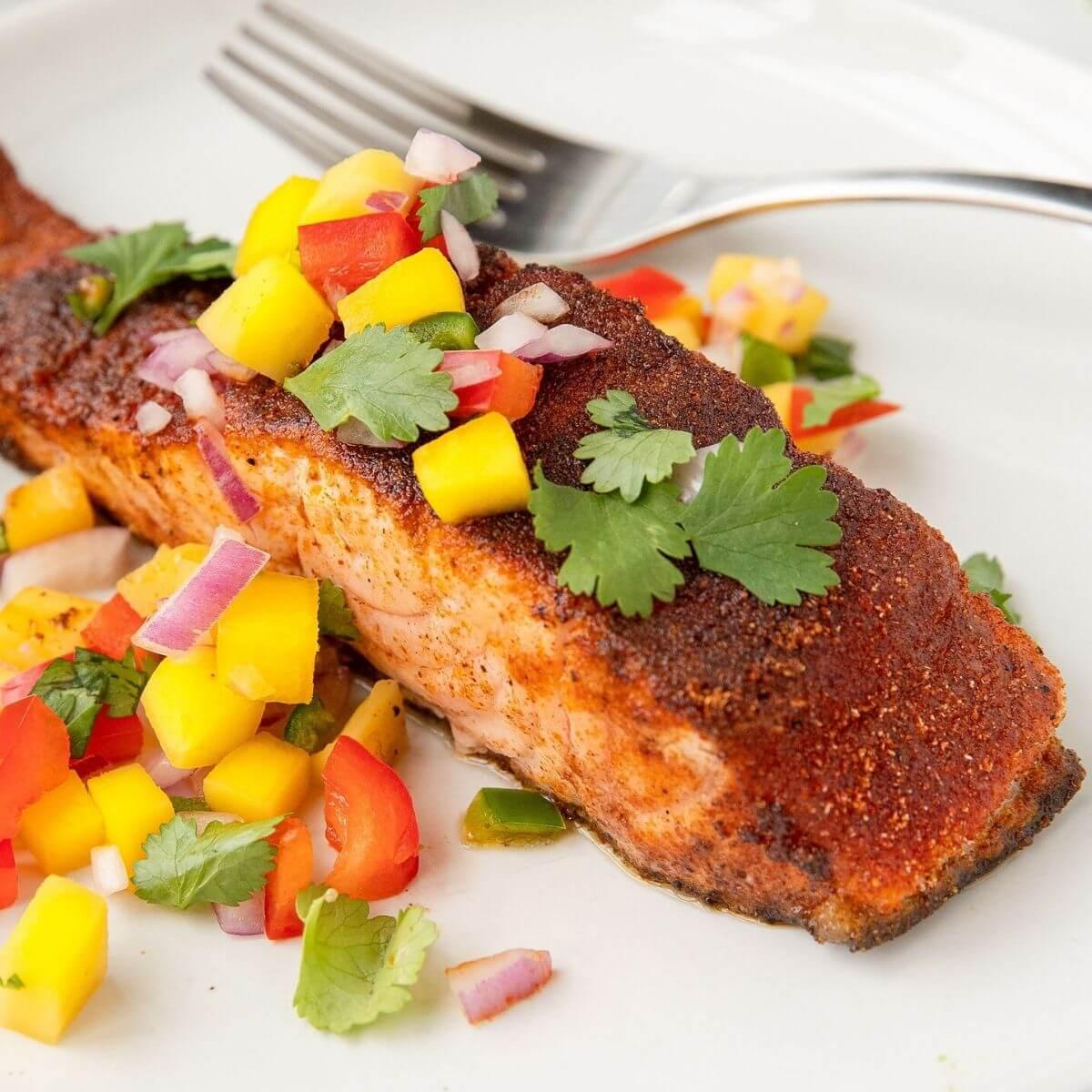 perfect pan seared blackened salmon with healthy fresh mango salsa