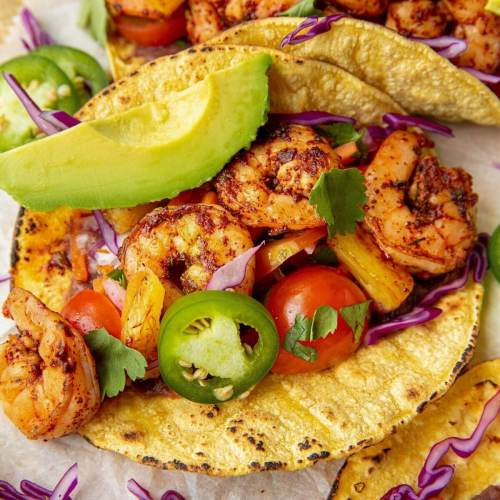 Healthy and easy al pastor shrimp tacos with pineapple and fresh carrot slaw