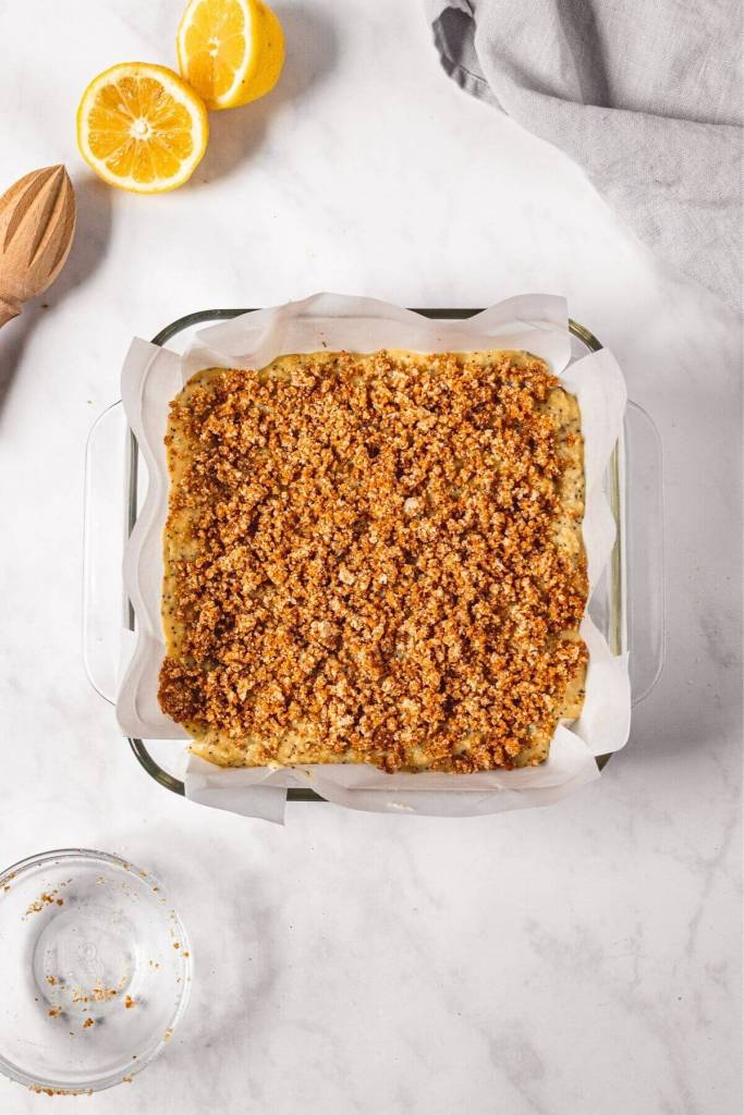 Lemon poppy seed cake batter with crumble topping before baking