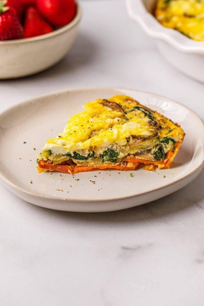 slice of healthy spinach mushroom feta and sweet potato crustless quiche