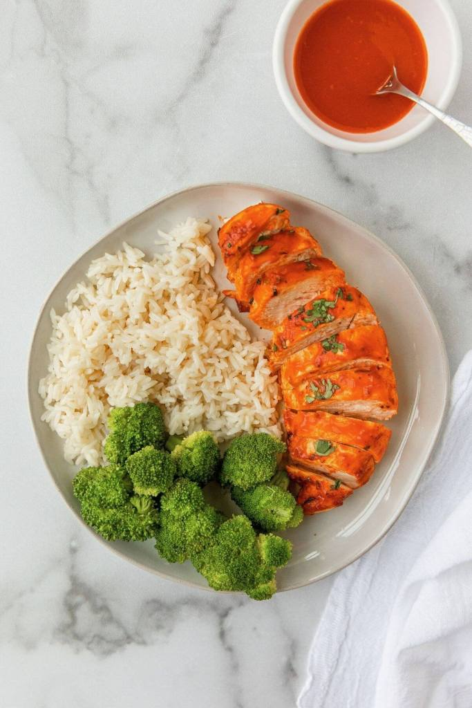 easy air fryer buffalo chicken with rice and broccoli