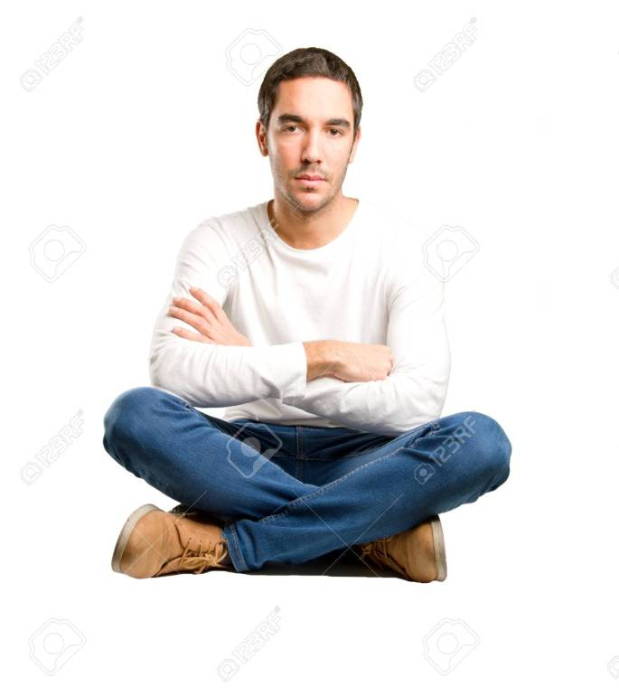 Seated young man with crossed arms gesture