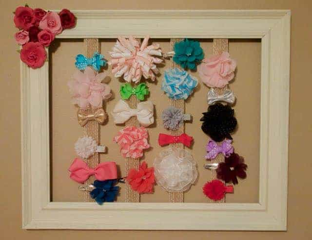 Look at this super simple, and very adorable, DIY hair bow holder. It's a great way to organize, and display, all your daughter's hair bows.