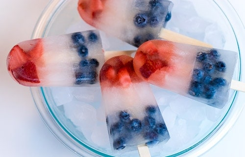 These simple and healthy red, white, and blue patriotic popsicles are so refreshing! With only 3 ingredients, they make it easy to add a festive flair to any holiday gathering.
