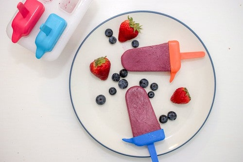 These healthy fruit and yogurt popsicles are easy to make and only contain three ingredients. So, there's no guilt in eating or sharing with your kids!