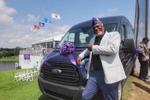 Tony Goodson poses with van
