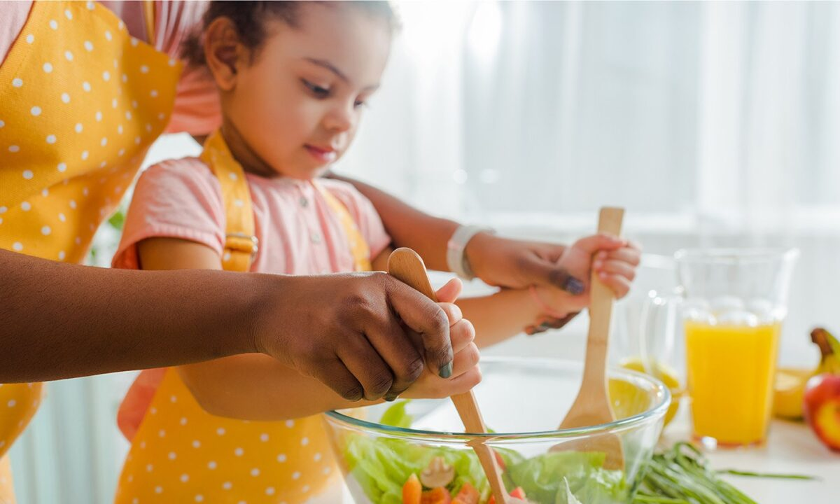 Young-Girl-Tossing-Salad-With-Mom