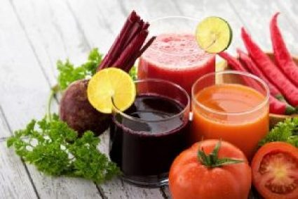 fresh fruit and vegetable juice on the table