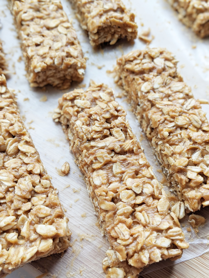 Just 5 ingredients and 5 minutes to whip these up. These bars are so easy to make, you'll never buy store-bought granola bars again. They are very filling, boasting 9g of protein using only whole food ingredients, and are vegan and gluten free! #granolabar #vegansnack #easysnack #vegan #glutenfree #healthysnack