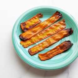 This carrot bacon recipe is so easy and great for when you want the delicious sweet and smoky-ness of bacon! Just 8 simple ingredients, a peeler, and an oven or air-fryer is all you need. Vegan bacon can be made in many ways but this carrot bacon is one of the simplest and most similar looking to actual bacon. And did I mention delicious? #carrotbacon #veganbacon #plantbased #vegan #veganrecipe #veganbreakfast #plantbasedbreakfast #meatfree #meatlessmeals