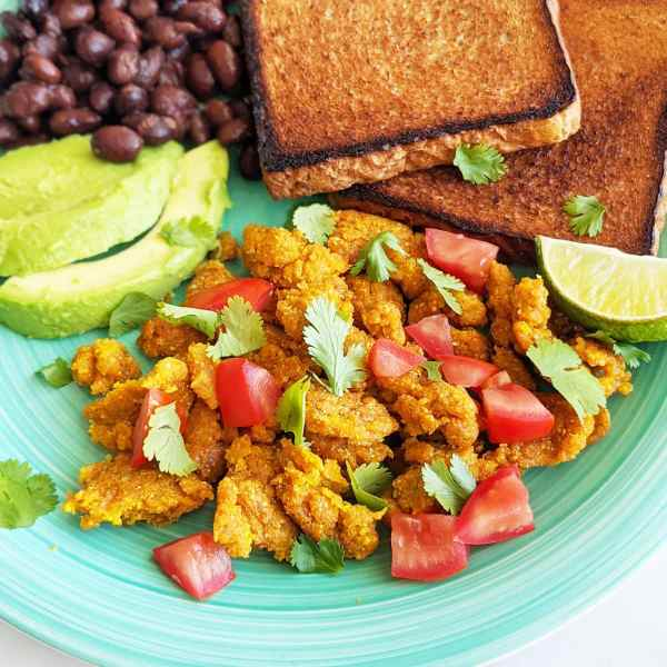 chickpea flour scramble with chopped tomatoes and cilantro