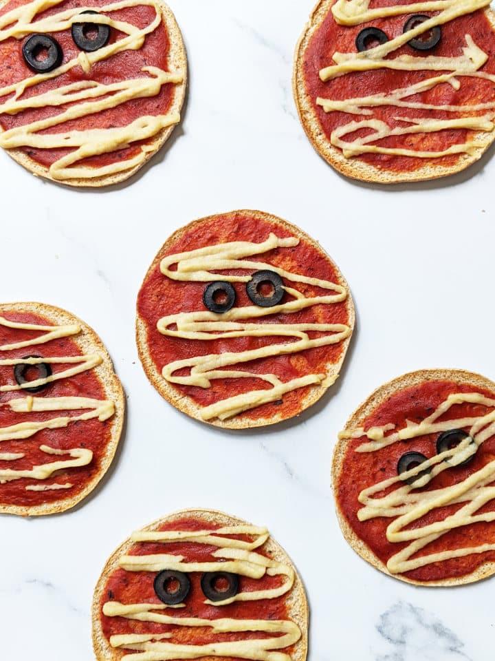 Mini Vegan Halloween Pizzas designed to look like mummies