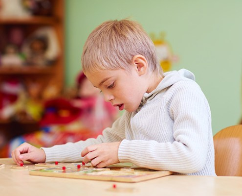 Young boy doing a jigsaw