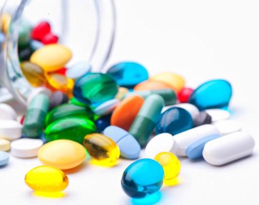 Pills spilling from a jar