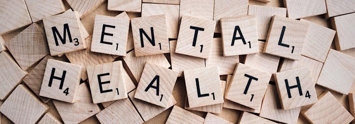 Wooden blocks spelling 'mental health'