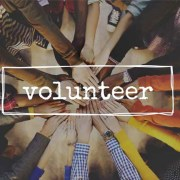 People joining hands with the word Volunteer