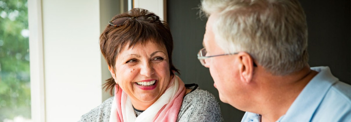 Middle aged woman chatting to a man