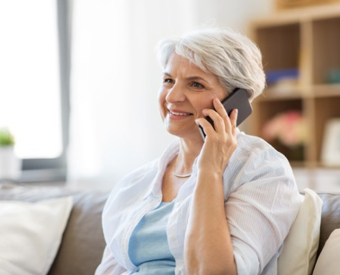 Older lady talking on the phone