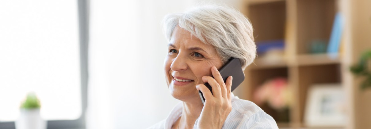 Older lady smiling and talking on the phone