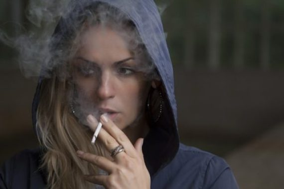 A pregnant woman smoking can cause serious harm to the unborn child