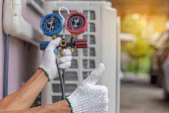 Man providing HVAC maintenance.