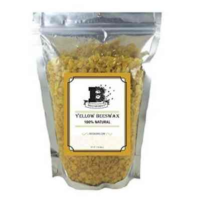 Bag of yellow beeswax pastilles for homemade deodorant.