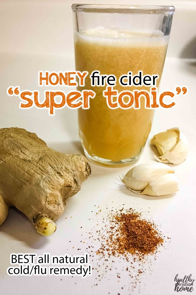 honey fire cider super tonic in a small glass