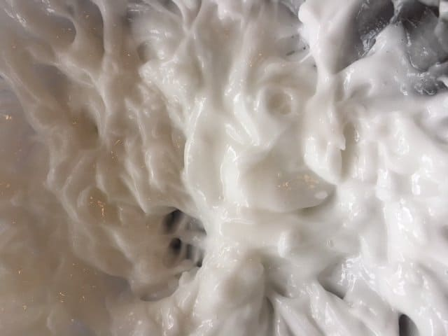 Close-up of creamy, smooth homemade lotion.