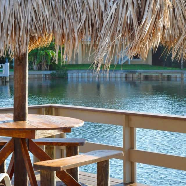 Tropical dining table on a boat dock on the bay.