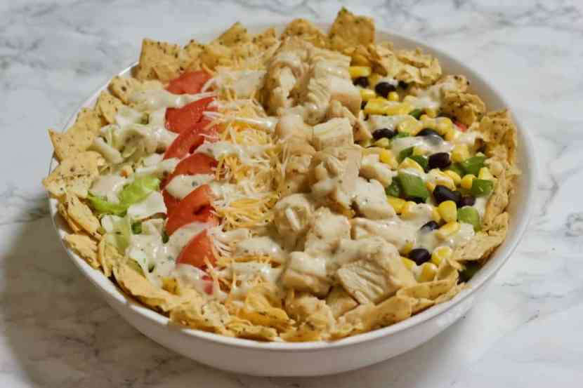 Quick n' Easy Southwestern Chicken Cobb Salad | A lightened-up version of a traditional chicken Cobb salad with a Southwestern twist! Made with fresh veggies, grilled chicken, beans, low-fat cheese, and yogurt-based ranch dressing. A perfectly balanced meal with tons of flavor and healthy ingredients!